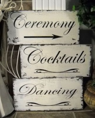 Shabby chic wedding signs will help direct guests into the restaurant
