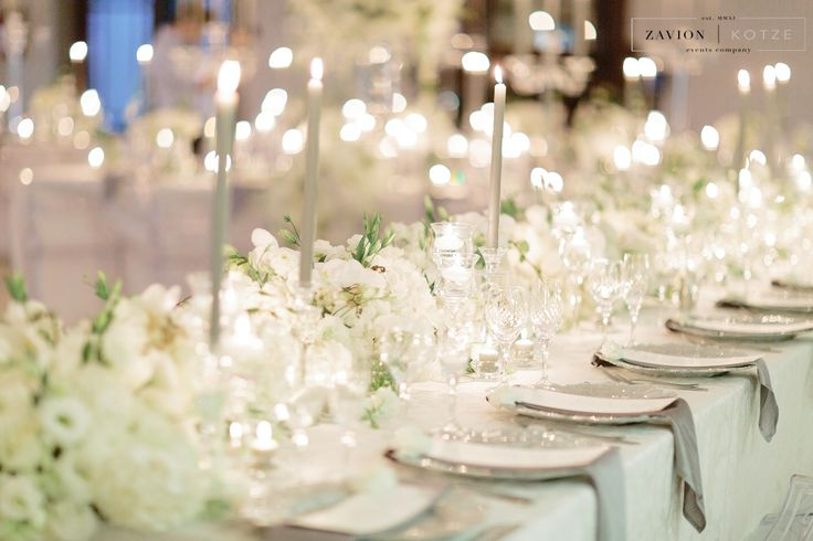 Crisp white flowers, softened by champagne table cloths and soft candle light. Floral runner with orchids and white roses. Luxe Wedding, Royal Wedding, Orchids, mass arrangements, large wedding flowers, luxury wedding. Photographer Rensche Mari