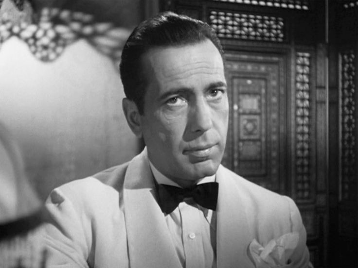 Humphrey Bogart plays Rick Blaine, who runs a bar and casino in 1940's Casablanca. Description from questionofpretension.wordpress.com. I searched for this on bing.com/images