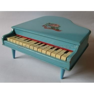 Wooden toy piano, 1960s. I had one of these, same colour but no flowers on the top