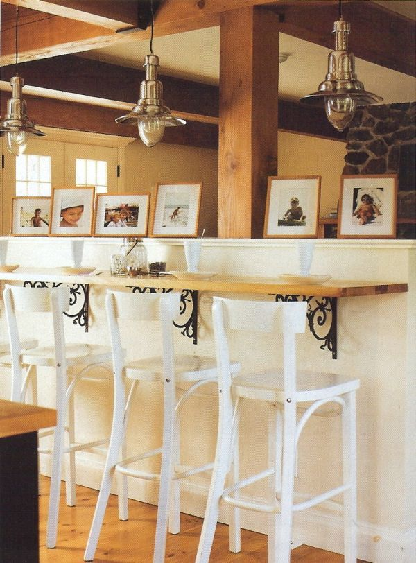 I love the brackets used here! Kitchen Breakfast Bar Ideas | Create a warm, welcoming space by adding family photos.