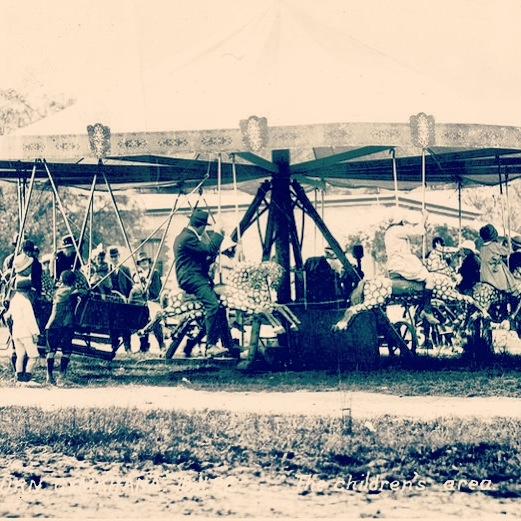 Yallourn Gymkhana, Australia, 1911. Children's area. Likely to be a Briggs (early show family, continuing today and in their 7th generation of showies) horse-a-plane. For more info add Bounty Historical on Facebook.