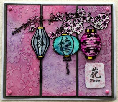 handmade card from Crafter's Companion USA Information Blog : A Little Bit Oriental Collection ... three panel card on a black cardstock base ... cherry blossom embossing folder texture with inking adding depth ... lovely landtens hanging from sakura blossom branch ... beautiful card!