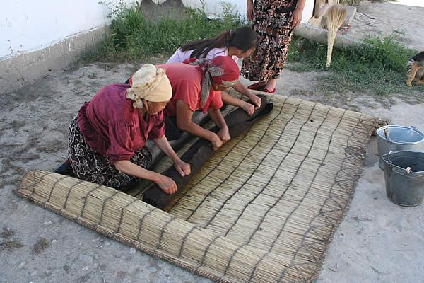 The women of At Bashi making Shyrdak traditional felt rugs, using the ancient nomadic felt making techniques