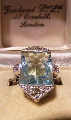 Art Deco Aqua Marine and diamond ring. Fresh, exciting art deco antique ring. c1930 this antique aqua marine ring has it all. Top quality, style, and statement. Old Mine cut diamonds of approx. 0.80 pts enhance this fresh large antique aqua marine ring. Dimensions of aqua marine gem stone - 15mm x 12 mm White metal - untested diamond content approx. 0.80 pts