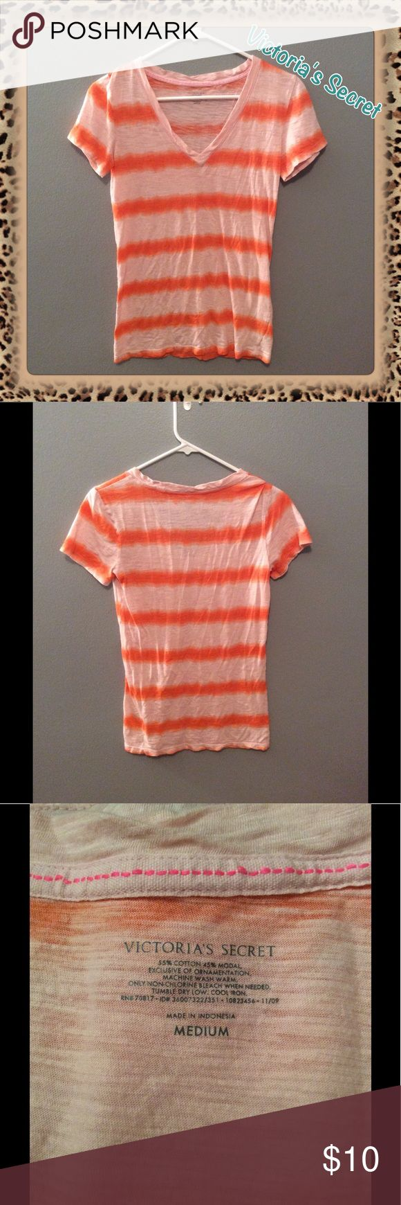 EUC Victoria's Secret V-Neck Tee Excellent used condition (maybe even NWOT, can't remember) - has been stored in a tote; no marks, rips, holes, piling, etc. Please see last photo for material & washing info. No trades. Lowest price unless bundled. Comes from smoke & pet free home. Don't hesitate to ask any questions! Victoria's Secret Tops Tees - Short Sleeve