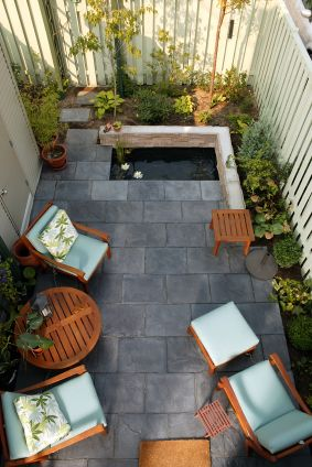 Tiny courtyard still gets a koi pond, because the client really wants one. Find the client's dream about their yard space, dig down to the central feature that spells success to them, shape the rest of the space around that element.