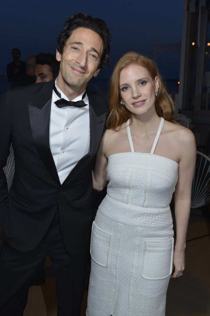 Adrien Brody in Louis Vuitton and Jessica Chastain in Chanel. [Photo by Stéphane Feugère]