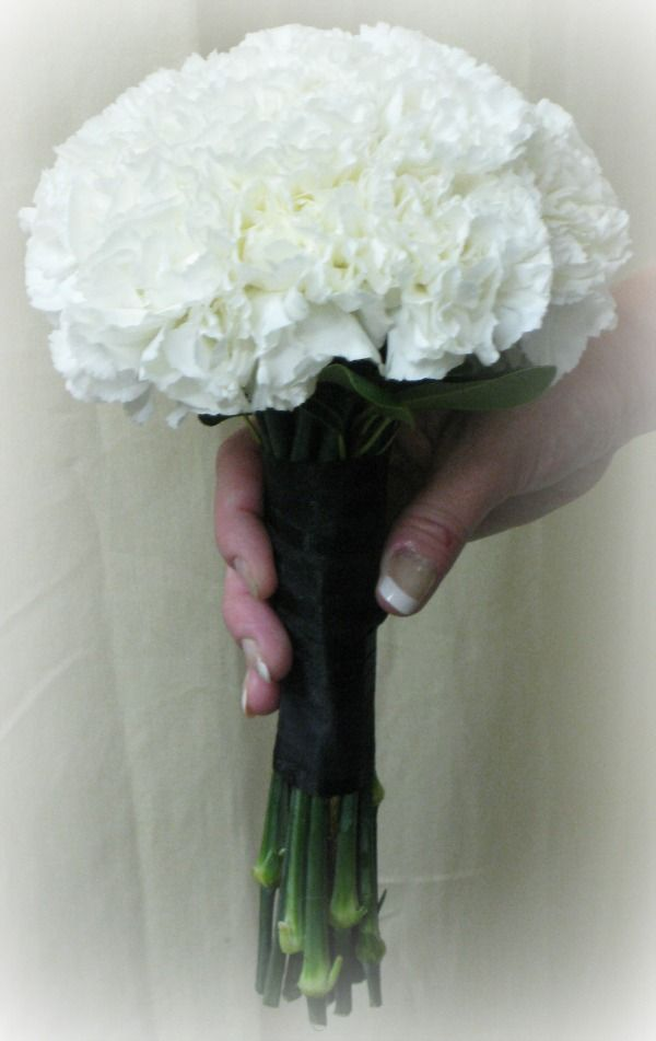 Carnation bouquet. They get a bad rap, but they're frilly, pretty, and inexpensive! Also, it's the January birthday flower and  white carnations stand for luck, sweetness loveliness, innocence and pure love.