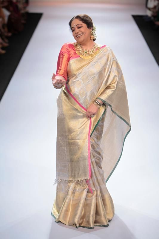 Kiron Kher looks great walking the ramp in all spirits in a traditional kanjeevaram by Gaurang Shah. Shop for the perfect wedding sari for your mother or mother-in-law with us. Bridelan - a personal wedding shopper & stylist for weddings. Website www.bridelan.com #Bridelan