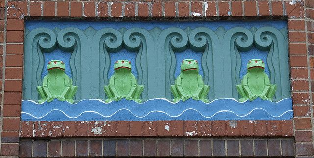Four unhappy-looking frogs on the facade of the North Sydney Olympic Pool, an Art Deco outdoor pool at Milsons Point just near the Sydney Harbour Bridge.
