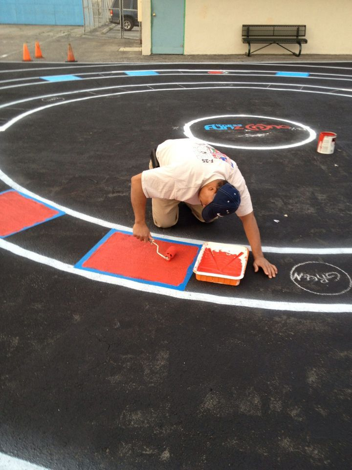 painting the fitness fun zone court on a school playground playground paintingplayground gamesplayground designpreschool