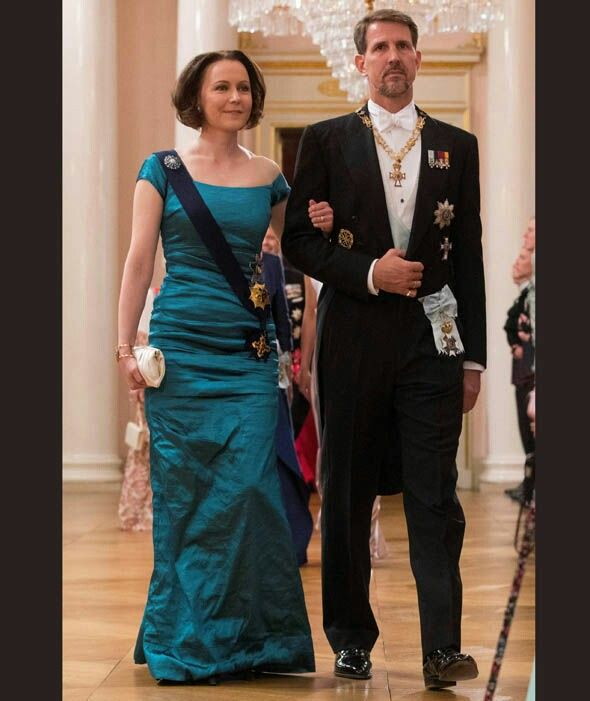 First Lady Of Finland, Jenni Haukio Is Escorted By Crown Prince Pablo Of Greece