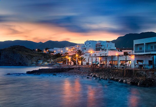 Spain - Cabo de Gata: Fishing Village Pastels ~~~ Powerful wind creates dramatic movement in the sky over a fishing village in Cabo de Gata in Spain.