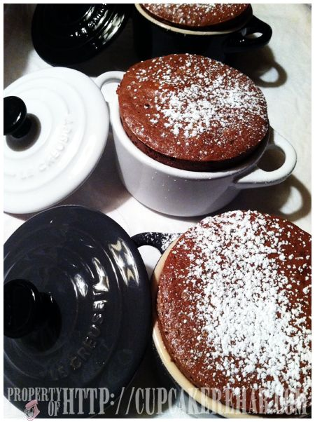 Chocolate souffle for mini cocottes. Ingredients: 2 tablespoons unsalted butter, softened ⅓ cup granulated sugar, plus more for ramekins 3 large eggs, room temperature, separated (whites & yolks) ⅛ teaspoon cream of tartar 5 ½ ounces bittersweet chocolate (70% cacao), chopped ⅔ cup whole milk 1 tablespoon plus 1 ½ teaspoons cornstarch ⅛ teaspoon salt 3 tablespoons creme fraiche or sour cream Confectioners' sugar, for dusting
