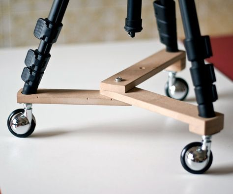 Small fold-able tripod dolly. To make movies you usually need to move smoothly your camera on a flat surface, like a table or the floor. There are many commercial tripod dollies but you can easily make your own with a few wood boards and three wheels.