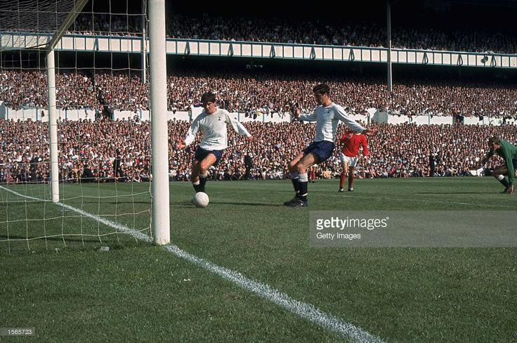 Cyril Knowles of Tottenham Hotspur clears the ball off the line at White Hart Lane in London...