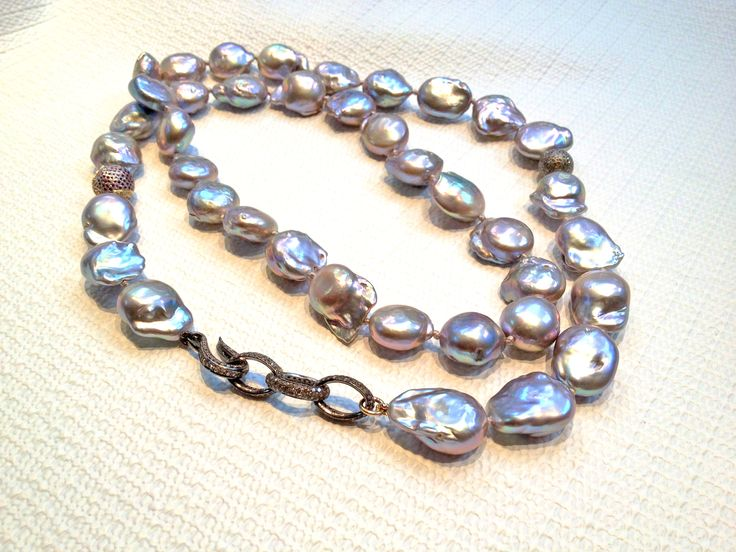 Grey #Baroque Freshwater #Pearls, double length necklace. This necklace can be worn long, or doubled up depending on your mood! It has Sterling #Silver #Pave #Diamond #Beads and a Silver Diamond Hook which attaches to a Custom Diamond #Chain Link as a #Clasp. #baroquepearls #freshwaterpearls #handmadejewelry #pavediamond #longnecklace