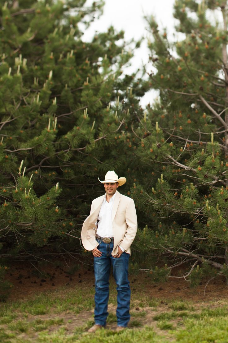 the groom, starched jeans, straw hat and tan jacket.