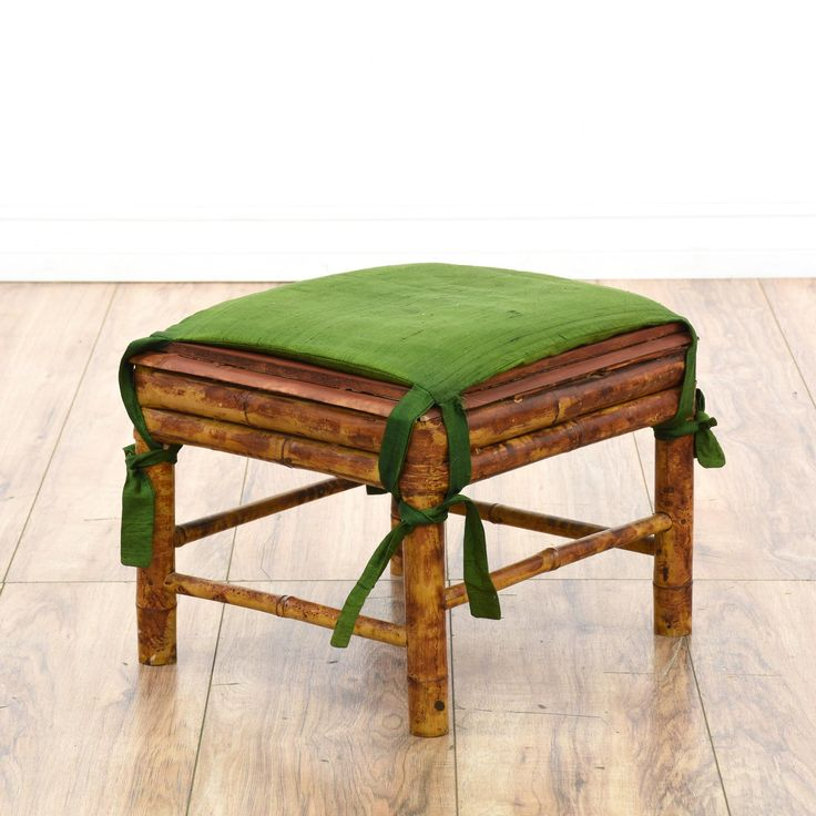 This asian ottoman is featured in a durable bamboo with a distressed red brushed finish. This footstool has a green fabric top with straight legs and a stretcher base. Great for an eclectic living room!  #asian #chairs #ottoman #sandiegovintage #vintagefurniture