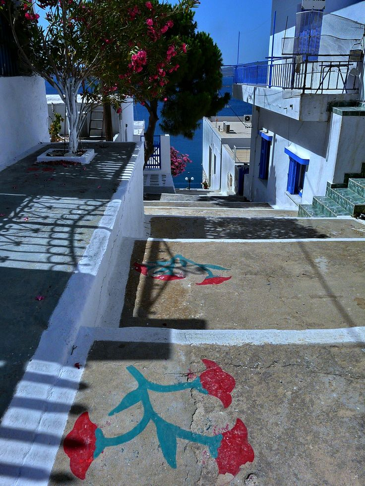 Adamas stepped street with painting. Milos island, Cyclades, Greece