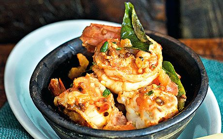 Prawns with garlic and chillies is easily one of my favourite first courses   for dinner parties, one that I have served repeatedly over the years, says   Madhur Jaffrey.