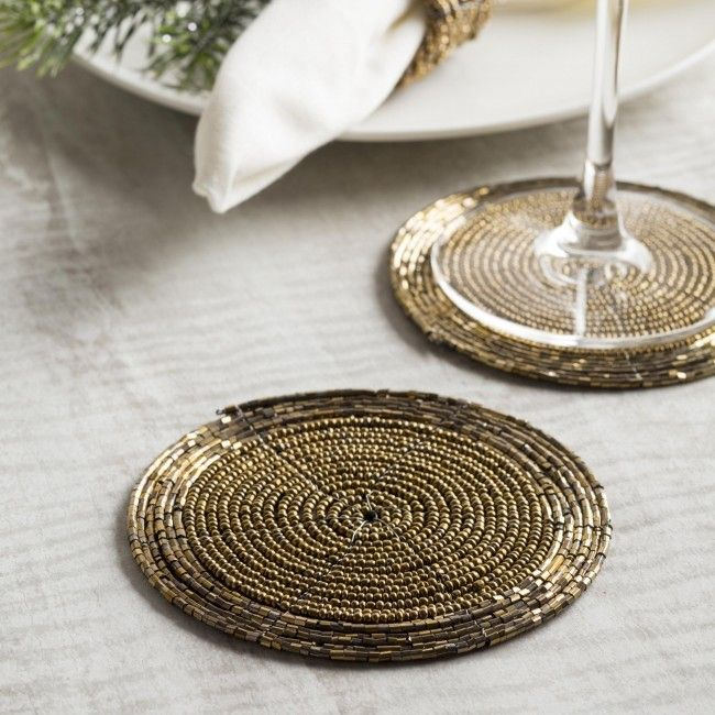 Bring some sparkle to your holiday table with a set of our Glitz Beaded Coasters.