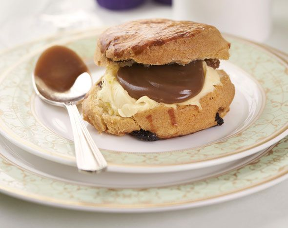 Warm freshly baked Buttermilk scones served with Devonshire clotted cream and – in place of the usual (yawn) jams – Paul A Young's award-winning Sea Salted Caramel spread - Paul A Young's Chocolate Inspired Afternoon Tea at the Grosvenor House Hotel