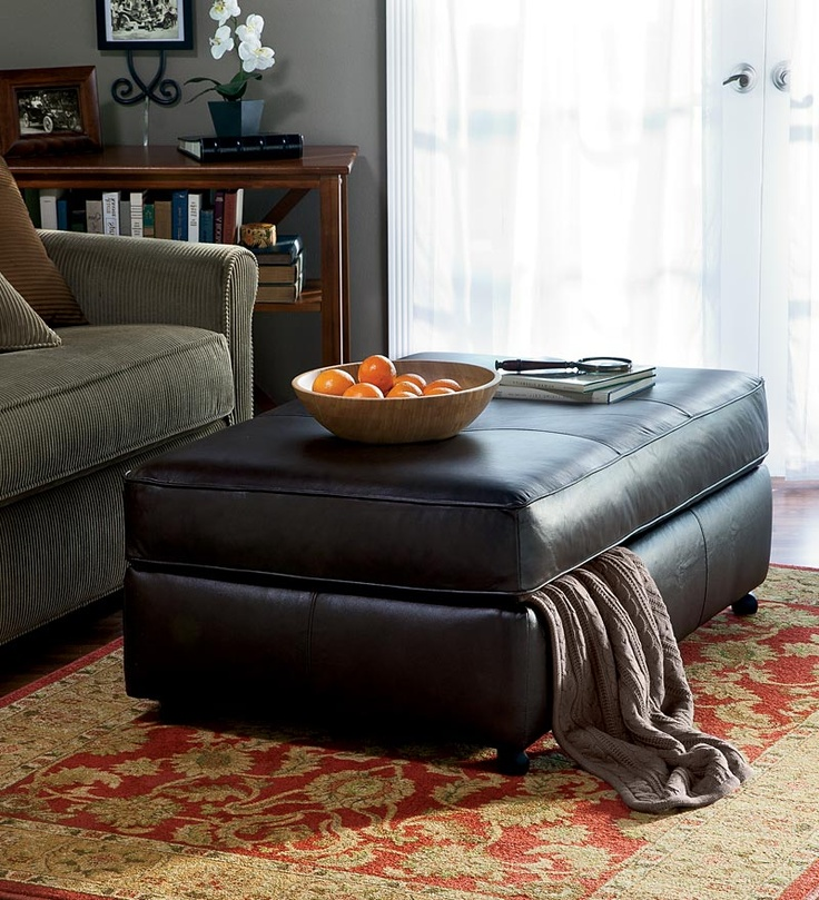 Totally want this storage ottoman... eliminate the hard corners on our current coffee table!