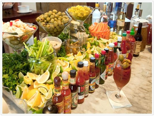 Great brunch/party idea -- a Bloody Mary bar!!  Serve a variety of hot sauces, horseradish, olives, celery, etc. YUM!