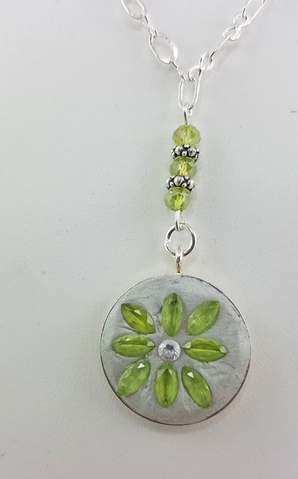 EDITOR'S CHOICE (03/01/2017) Peridot Delight by K. Lynn Designs View details here: http://jewelers.community/creations/4238-peridot-delight