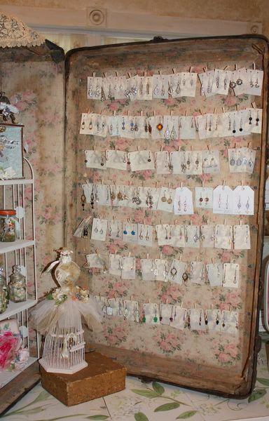 Craft show display idea use old suit case with cord strung from side to side for jewelry display.