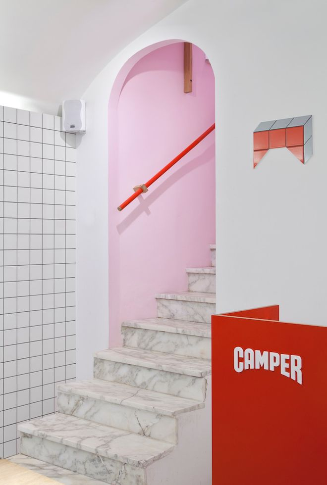 Pink, red, white, gray-Camper store, Genova by Tomás Alonso