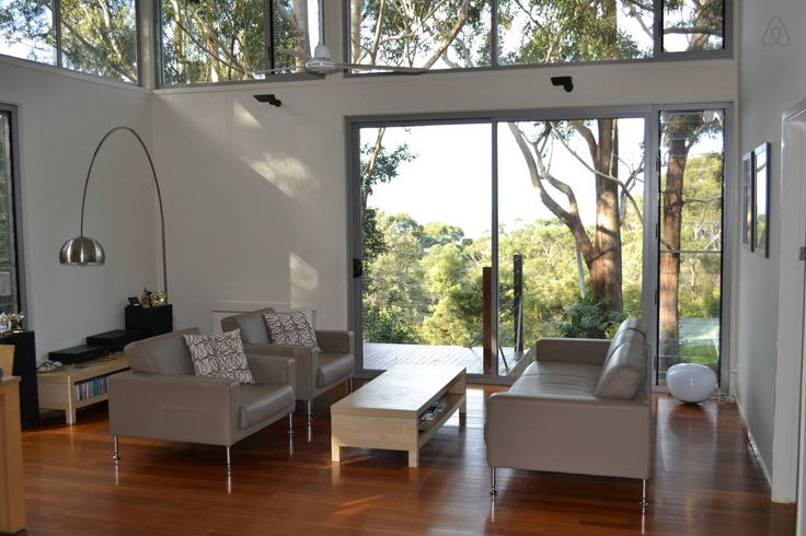 House in Wombarra, Australia. Modern, light-filled house on quiet, leafy half acre in the beautiful Illawarra escarpment, 500m to beach and ocean pool, 2km to Sea Cliff Bridge. Close to National Park, wonderful cafés, and many beaches. 150m to train and only one hour from Sydn...