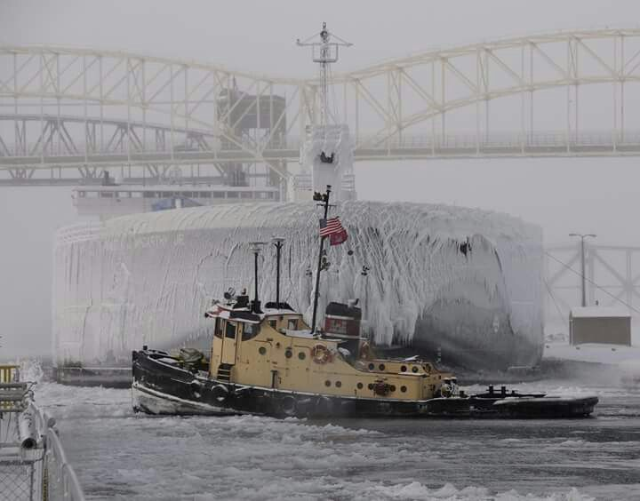 #PhotooftheWeek taken by Detroit District Employee, Carmen Paris. The Soo Area Office based tug Owen M. Frederick was breaking ice in and to the upper approach of the Poe Lock while the 1,000 footer M.V. Walter J. MC Carthy Jr. waits to lock down bound through the Poe Lock.