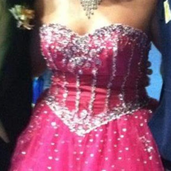 Stunning prom dress!!! Worn 1 time Gorgeous bright pink prom dress covered in bling the back is corset style so can be made smaller or larger! Mori Lee Dresses Strapless