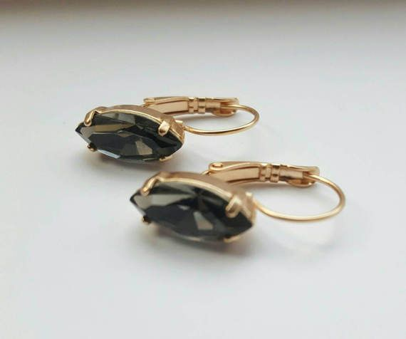 Check out this item in my Etsy shop https://www.etsy.com/ca/listing/502196190/black-diamond-navette-gold-earringgold
