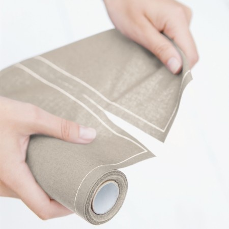 Disposable linen-look napkins on a roll