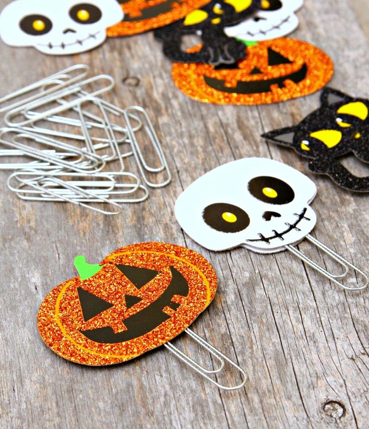 Halloween Paperclip Bookmarks- could use up some of those adhesive back foam cut outs that we've been storing for so long...