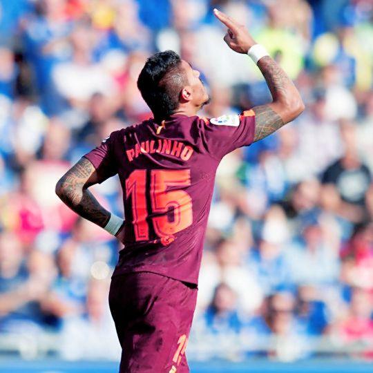 """Paulinho celebrates a goal during the league football match Getafe CF vs FC Barcelona at the Col. Alfonso Perez stadium in Getafe on September 16, 2017. """