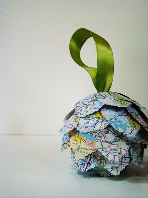 Kissing Ball Ornament Tutorial - rather than map, I envision leaf cutouts from old book pages (Pride and Prejudice) with shaded edges. They'd be lightweight for the little girls, very inexpensive, and could serve as part of the centerpiece on four reception tables.