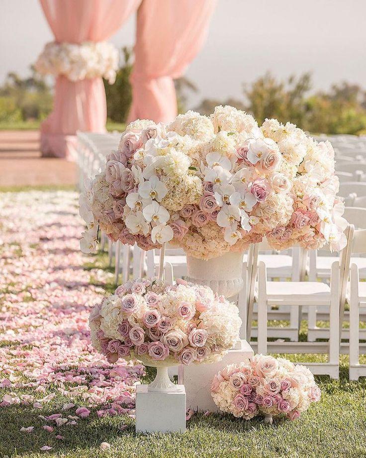 Glamorous wedding aisle decor ideas in pink, white.