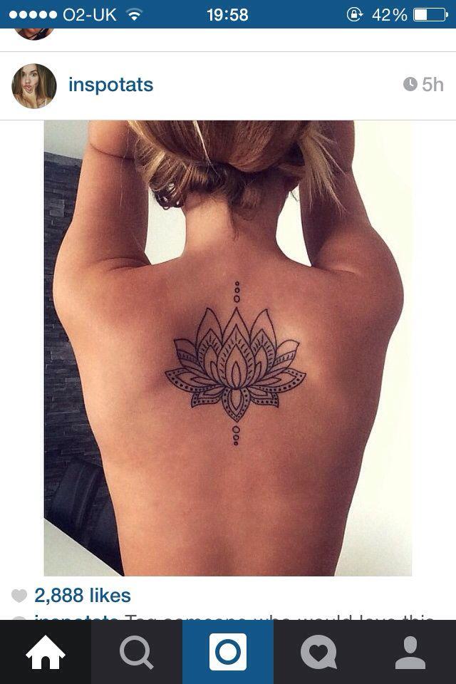 Lotus flower tattoo on back (woman)