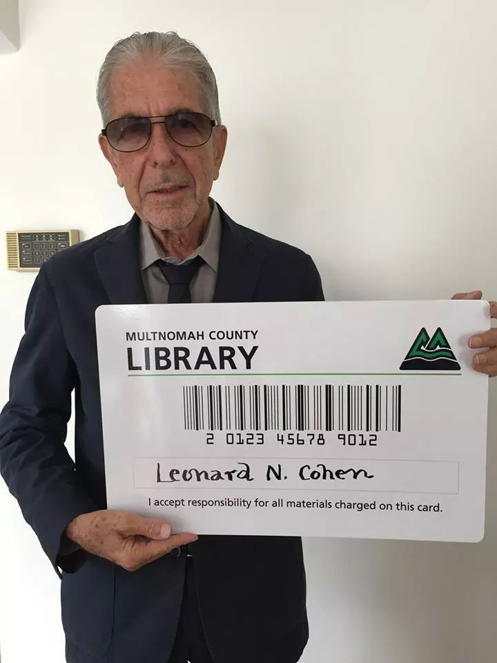 Leonard Cohen with his big card of Multnomah County Library