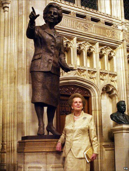 Baroness Margaret Thatcher stands in front of a bronze statue of herself, inside the Palace of Westminster, London.