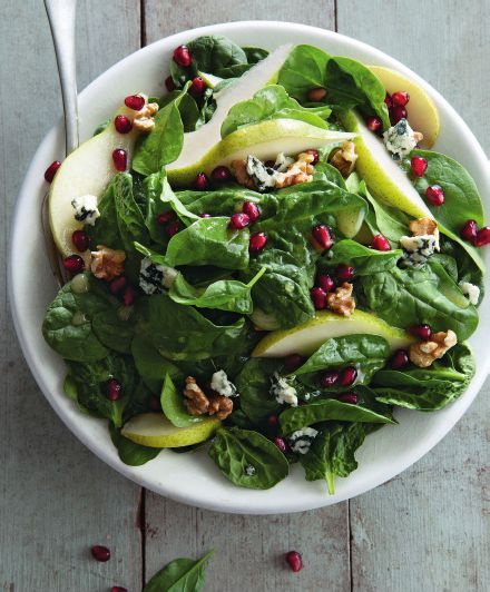 A refreshing, seasonal salad to get kick off the Thanksgiving feast. Red pomegranate seeds glitter like jewels on the blanket of greens.