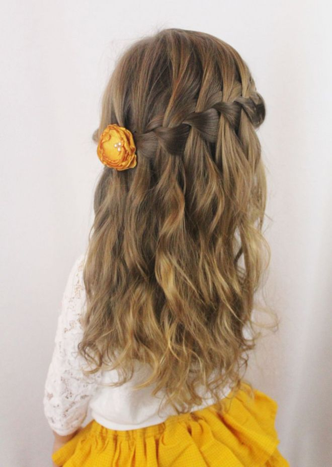 This is a waterfall braid which you start at one side and work your way around the back. Perfect for those with thick and wavy hair.