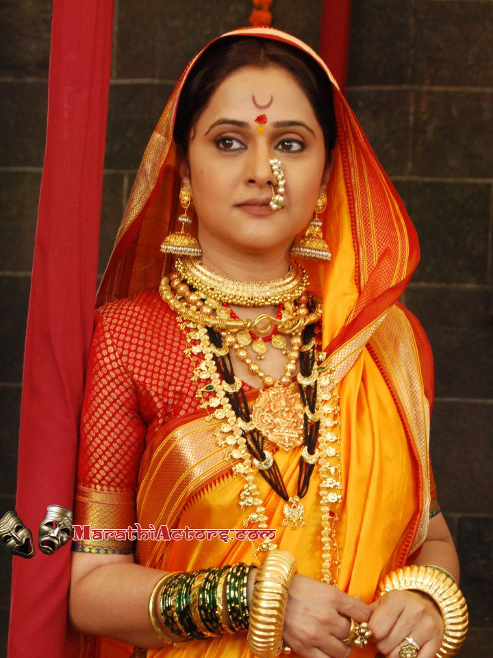 Marathi Style in a Bright Yellow Saree with a Red and Gold Blouse