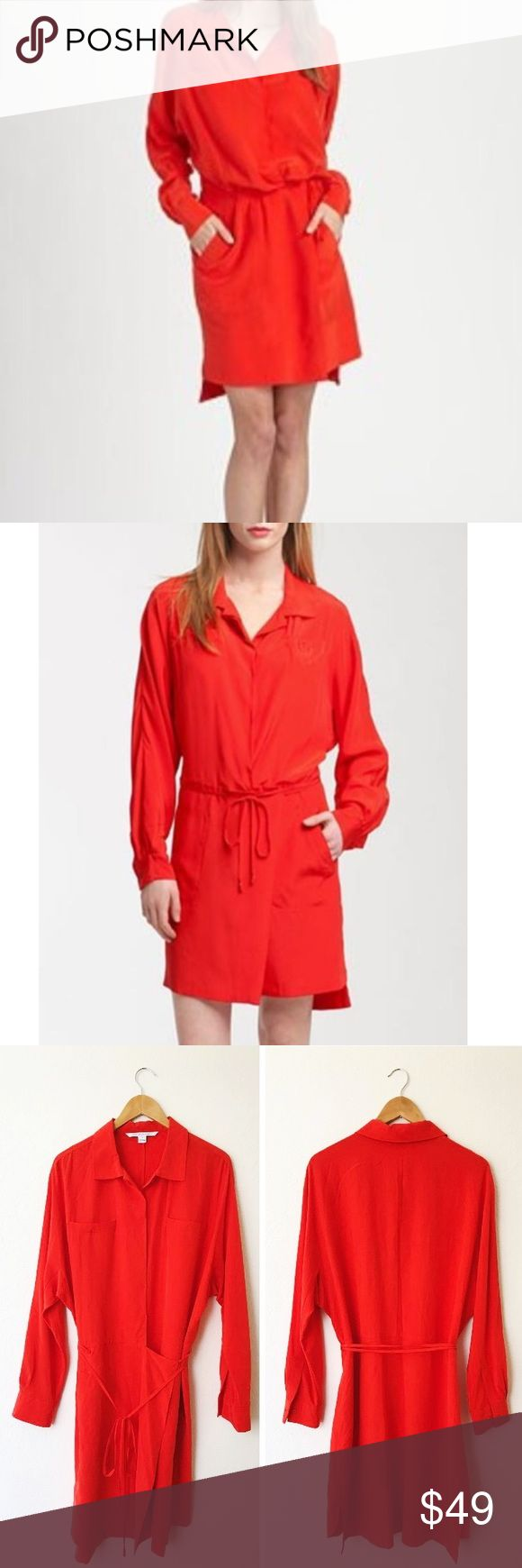 "DVF Rosetta Wrap Shirtdress in Cherry Very good preowned condition, hidden buttons halfway down the front, Wrap Skirt effect with tie around waist, long sleeves, pocket at the chest. Last picture shows some spots in the back of the right shoulder area, otherwise Dress is in excellent condition. Would need to be dry cleaned. Price reflects imperfection. Color is like a deep coral color but is officially called ""cherry."" 100% silk, worn once. Diane Von Furstenberg Dresses Long Sleeve"