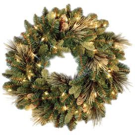 Welcome friends, family, and neighbors in chic style for the holidays with this lovely accent, showcasing flocked pinecone accents against clear lighting.   Product: Wreath   Color: Green and brown  Features: Trimmed with flocked pine cones Pre-lit with clear lights   Includes spare bulbs and fuses   Will enhance any décor